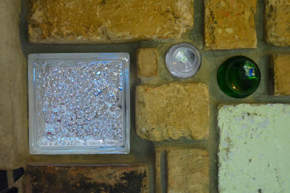 Reclaimed Bricks and Colourful Bottle Glass are part of the Hundertwasser Toilet New Zealand