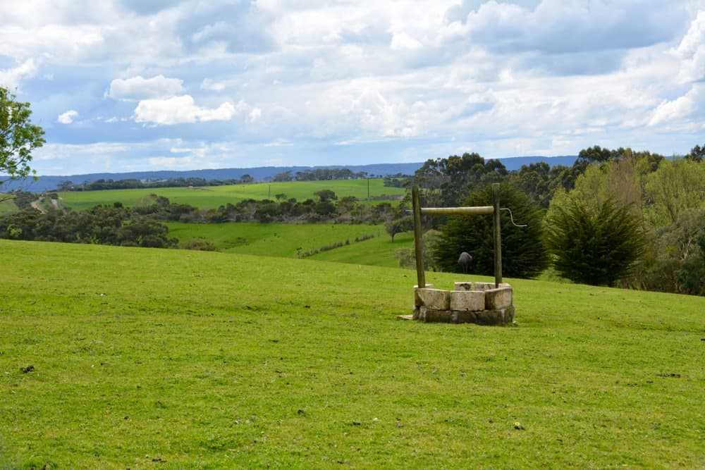 Views across the farm with a well