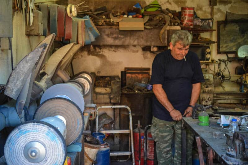 Artisan in the Street of Knives working on some of the best knifes in all of Greece.