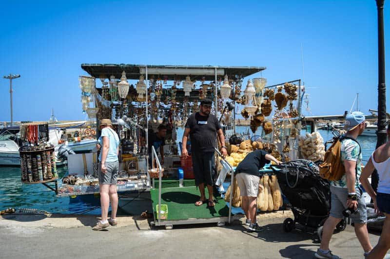 Browsing the funny swimming souvenir shops in Chania's harbour is among the great things to do in Chania.