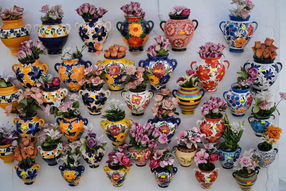 Colourful pots and flowers for sale in Mijas. Spain has a long ceramic craft tradition. It's hard not to go home without at least one handprinted tile or plate in your suitcase.
