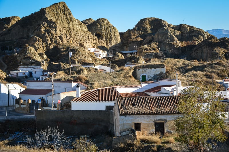 Views of Guadix with its cave dwellings. Some locals will invite you to have a look inside their houses (they are actually quite comfy!).One of our top tips for our Andalusia Travel blog.