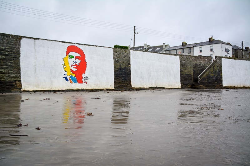 The colourful portrait of Che Guevara on the seawall in Kilkee, Ireland
