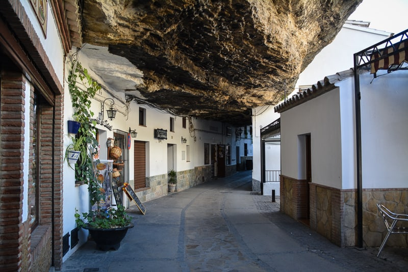 The cave houses of Setenil de las Bodegas are a fun and off-the-beaten-path destination just outside of Ronda. A visit to this small town can easily be added to the trip to Ronda. While Ronda is very busy with visitors from all around the world, Setenil is still largely untouched by international tourism which is a blessing.