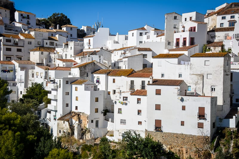 White villages like Casares were founded by Arab settlers who introduced North African building techniques to the European continent. The white walls are great to keep the houses cool in summer.