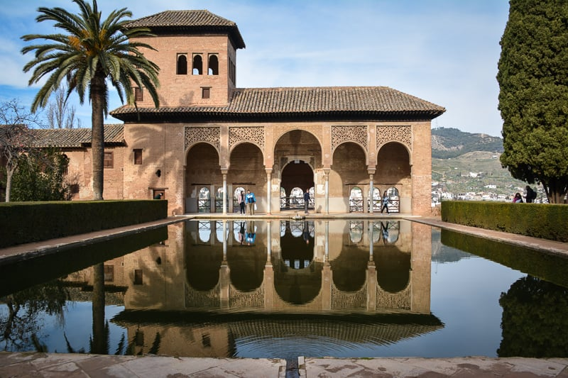 One of the palaces of the Alhambra in Granada. Water and light play an integral part in Arab architecture. You can see water reflecting buildings, cooling the air, adding the trickling sound of water drops, and painting patterns of light on the walls and floors of rooms.
