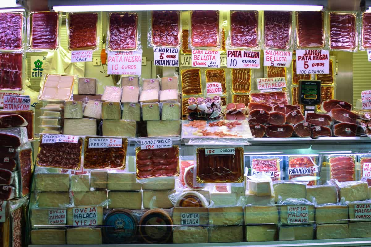 Hams and cheeses are a specialty of Spain. This stall at the markets sells the very best products, which shows in the price tags.