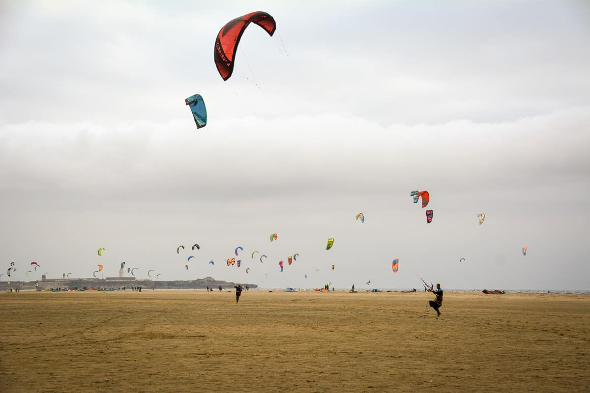 Watching the colourful kites dance against the stormy skies of Tarifa.