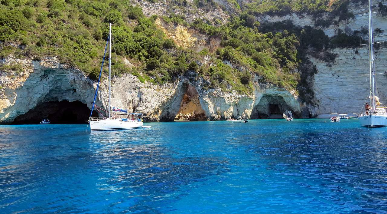 The Blue Caves of Antqpaxos are among the most beautiful destinations you can visit on a boat trip from Corfu.