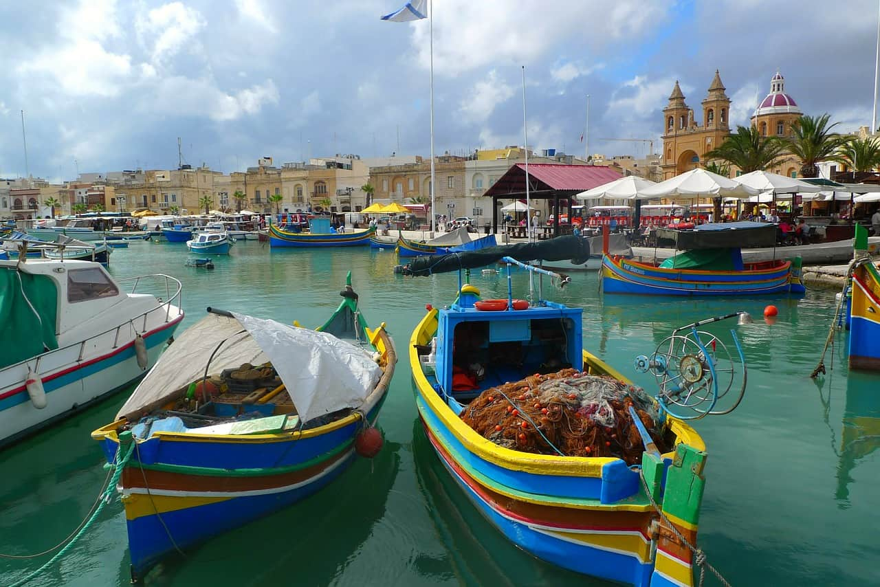 The colourful fishing boats in Marsaxlokk are a popular photo opportunity for visitors to Malta. Photo: Pixabay/JanneG