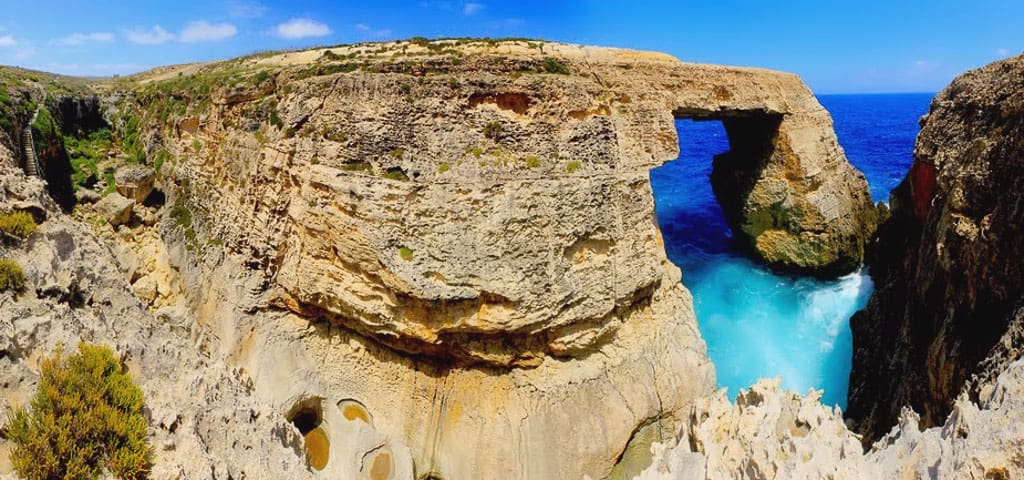 Since the collapse of the famous Azure Window in Gozo, Wied il-Mielah is a suitable alternative to see some coastal action in Malta. Photo: Wikimedia Commons/Alecastorina93