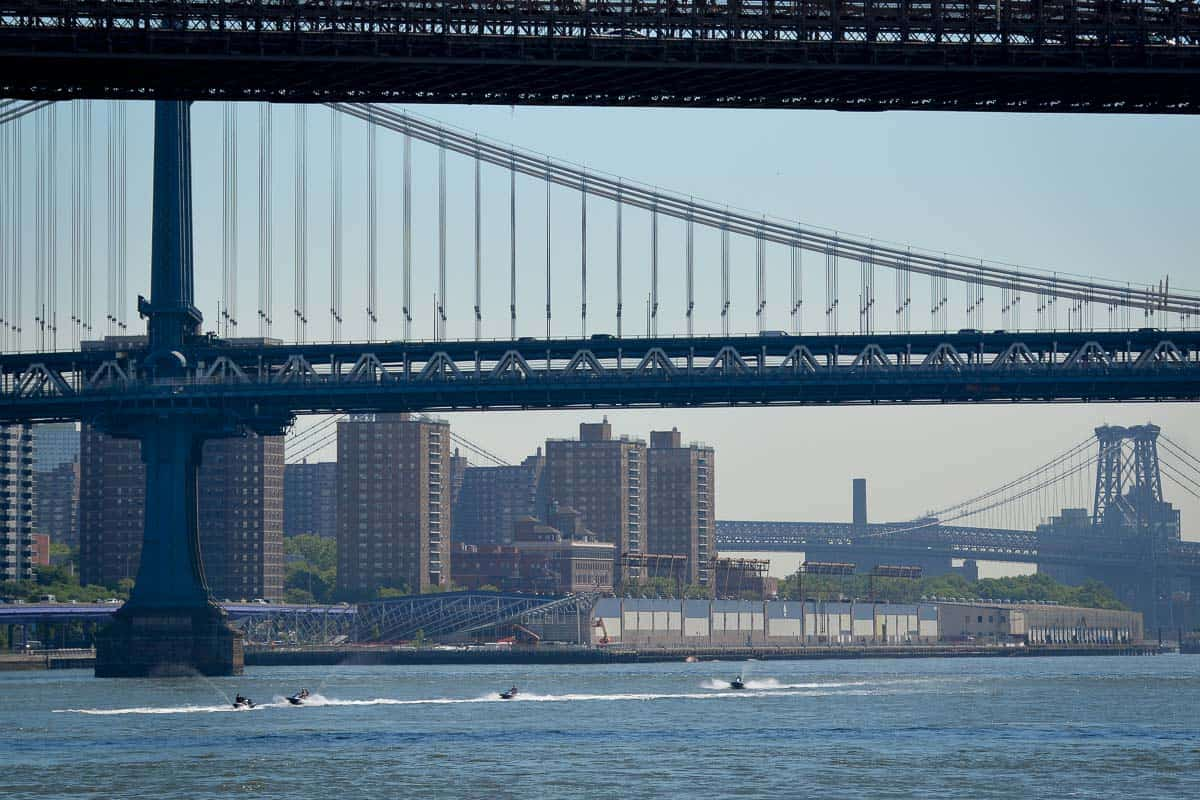 Daredevils racing their jet skis under the bridges of the East River.