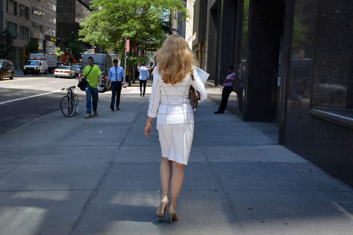 An elegant lady walking down the streets of Upper Manhattan.