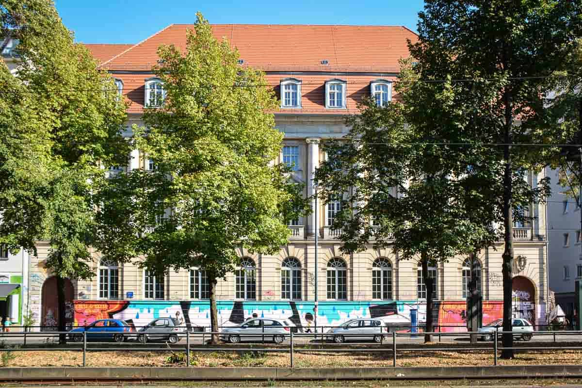 "A middle school in Berlin - what a wonderful old-style building, the lower part ""graced"" with graffiti, a tell-tale sign that this building must be located in Berlin."