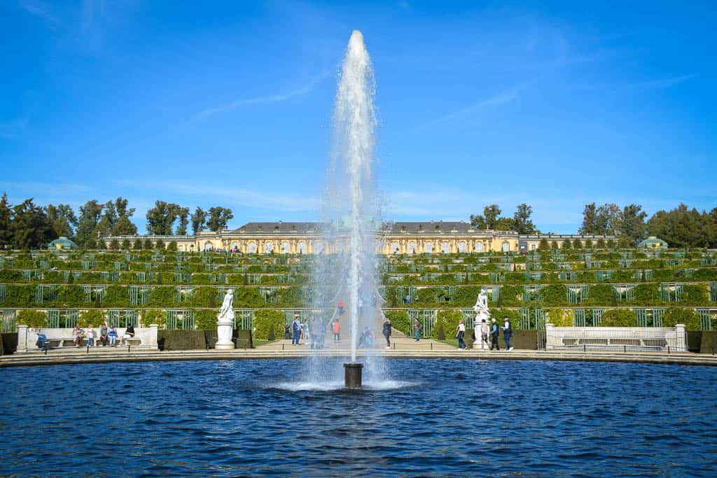 Sanssouci Palace looks surprisingly humble in the setting of the magnificent Pleasure Gardens.