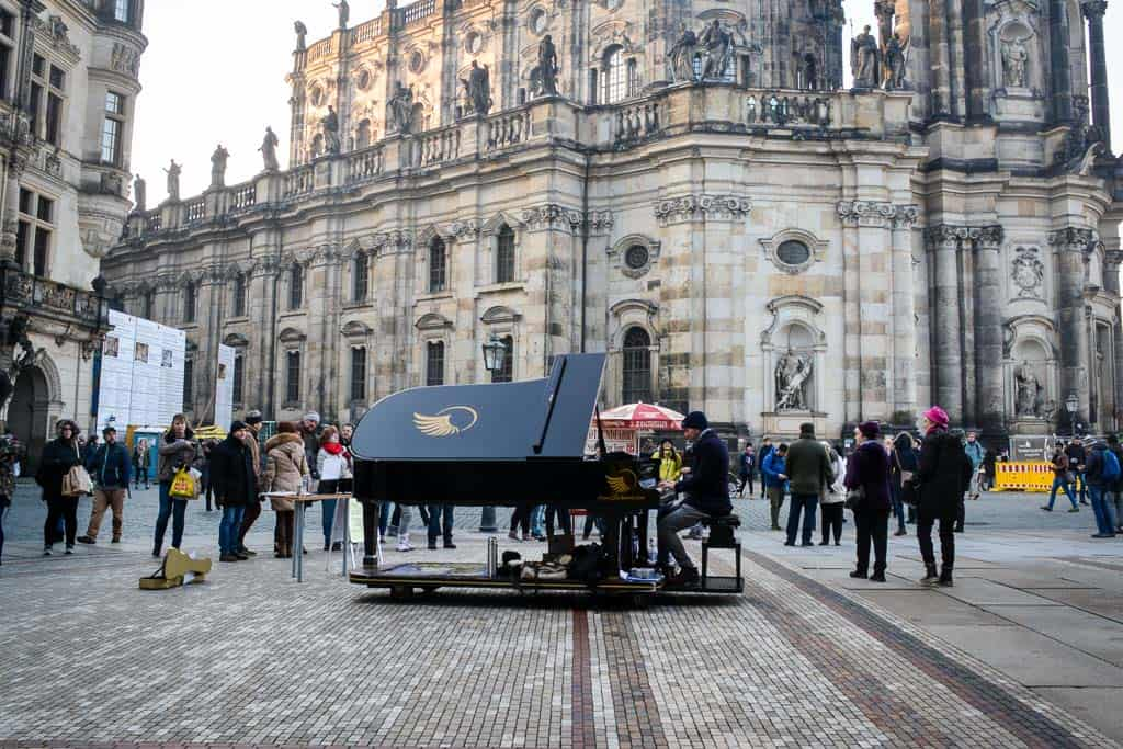 A busker on Schlossplatz playing Beyoncé's hits on a grand piano.
