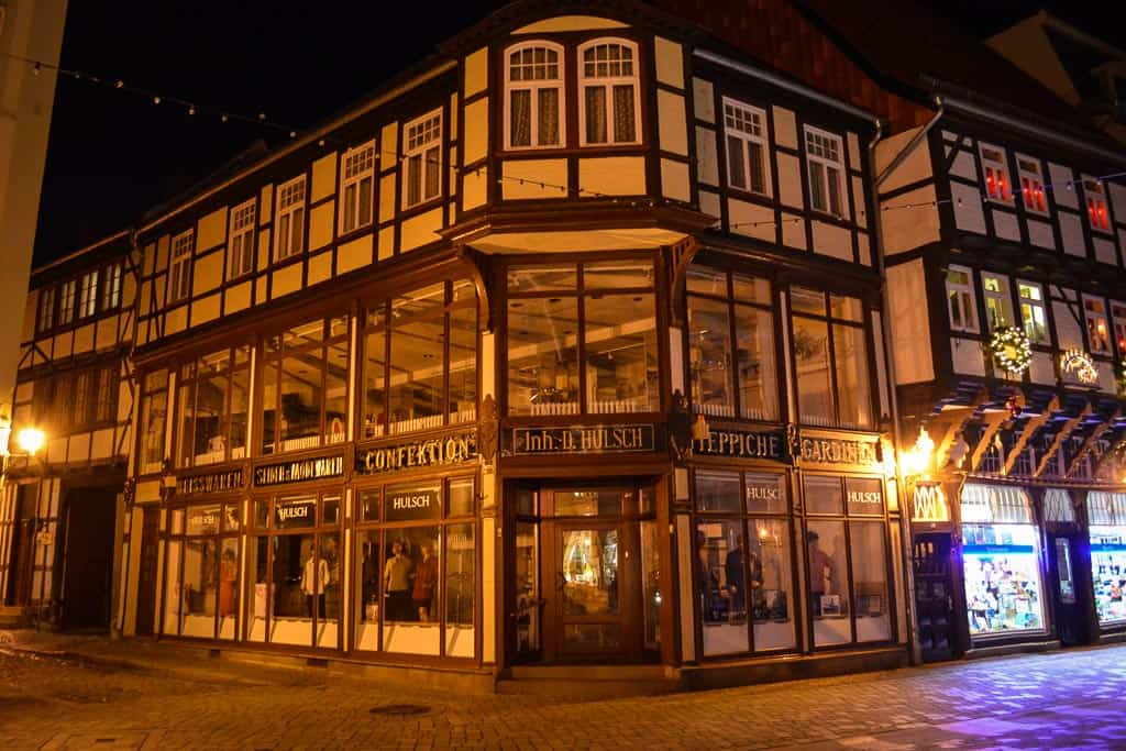 Timber-frame houses like this modernised fashion store appeal in the dark surroundings of the sleeping city.